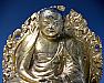 Tibetan Gilt Copper Repoussé Image of a Seated Lama